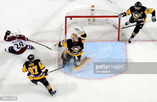 Tristan Jarry of the Pittsburgh Penguins makes a save against the Colorado Avalanche at PPG Paints Arena on December 11 2017 in Pittsburgh...