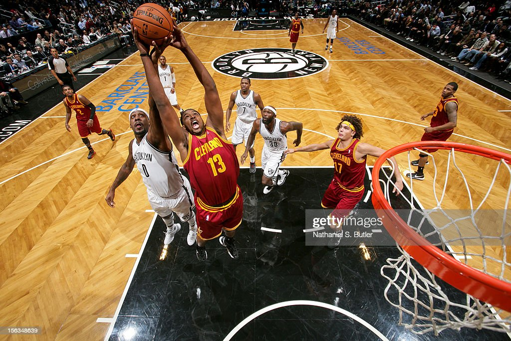 Tristan Thomas #13 of the Cleveland Cavalier grabs a rebound against Andray Blatche #0 of the Brooklyn Nets on November 13, 2012 at the Barclays Center in the Brooklyn Borough of New York City.