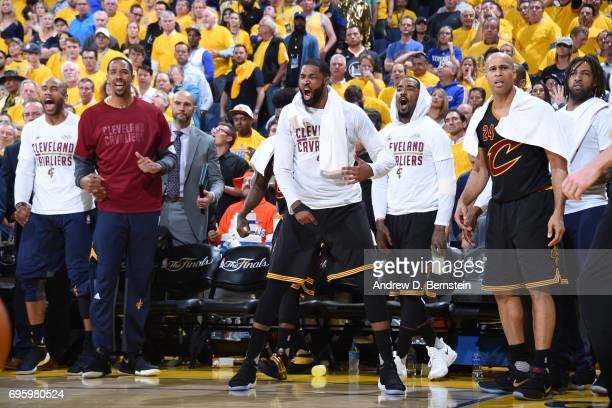 Tristan Thompson and JR Smith of the Cleveland Cavaliers cheer from the bench during the game against the Golden State Warriors in Game Five of the...