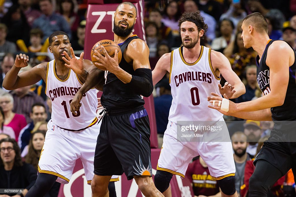 Tristan Thompson and Kevin Love of the Cleveland Cavaliers guard Tyson Chandler and Alex Len of the Phoenix Suns during the first half at Quicken...