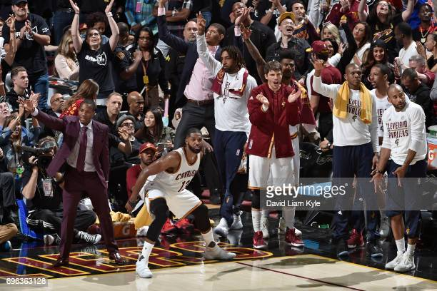 Tristan Thompson and Kyle Korver of the Cleveland Cavaliers cheer from the bench during the game against the Golden State Warriors in Game Four of...