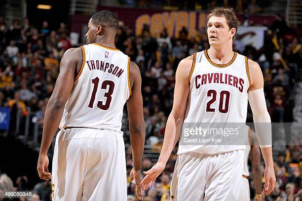 Tristan Thompson and Timofey Mozgov of the Cleveland Cavaliers high five each other during the game against the Brooklyn Nets on November 28 2015 at...