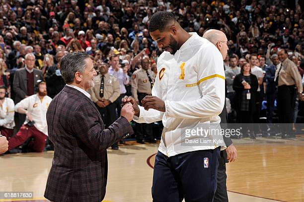 Tristan Thompson gets his championship ring presented to him by Dan Gilbert Owner of the Cleveland Cavaliers before the game against the New York...