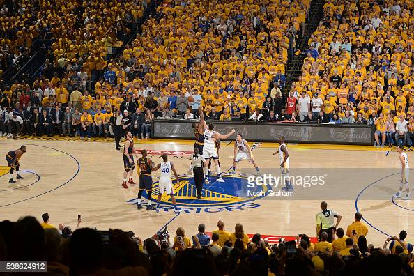 Tristan Thompson of the Cleveland Cavaliers and Andrew Bogut of the Golden State Warriors go up for the opening tip off during Game Two of the 2016...
