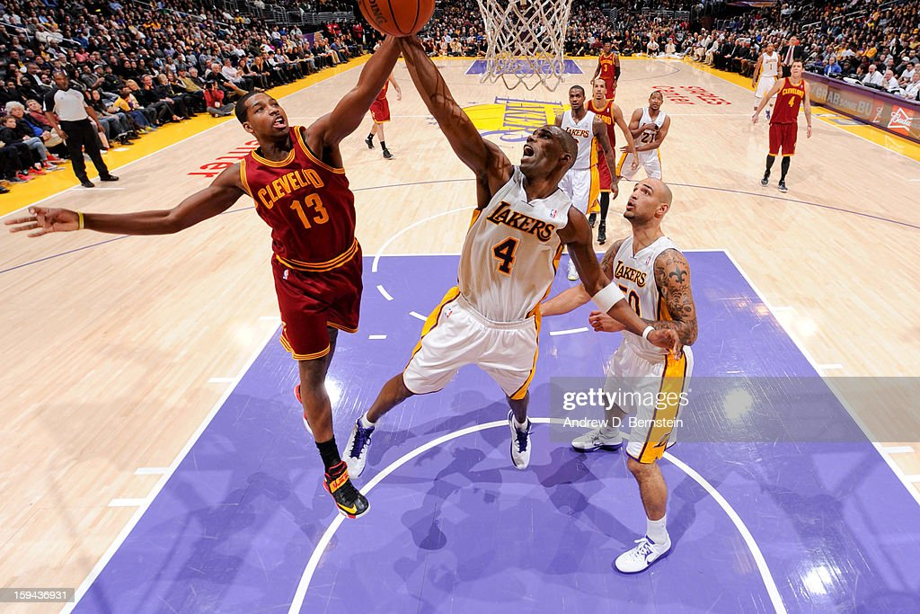 Tristan Thompson #13 of the Cleveland Cavaliers and Antawn Jamison #4 of the Los Angeles Lakers reach for a rebound at Staples Center on January 13, 2013 in Los Angeles, California.