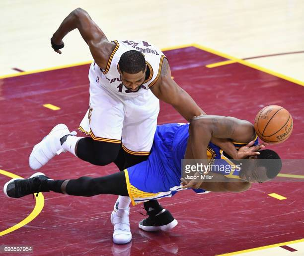 Tristan Thompson of the Cleveland Cavaliers and Draymond Green of the Golden State Warriors compete for the ball in the third qurater in Game 3 of...