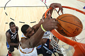 Tristan Thompson of the Cleveland Cavaliers and Team Chuck dunks the ball over Michael KiddGilchrist of the Charlotte Bobcats and Team Shaq in the...