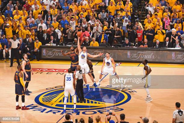 Tristan Thompson of the Cleveland Cavaliers and Zaza Pachulia of the Golden State Warriors go up for the opening tip off in Game One of the 2017 NBA...