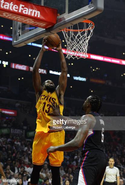 Tristan Thompson of the Cleveland Cavaliers attempts a dunk against DeAndre Jordan of the Los Angeles Clippers on March 18 2017 at STAPLES Center in...