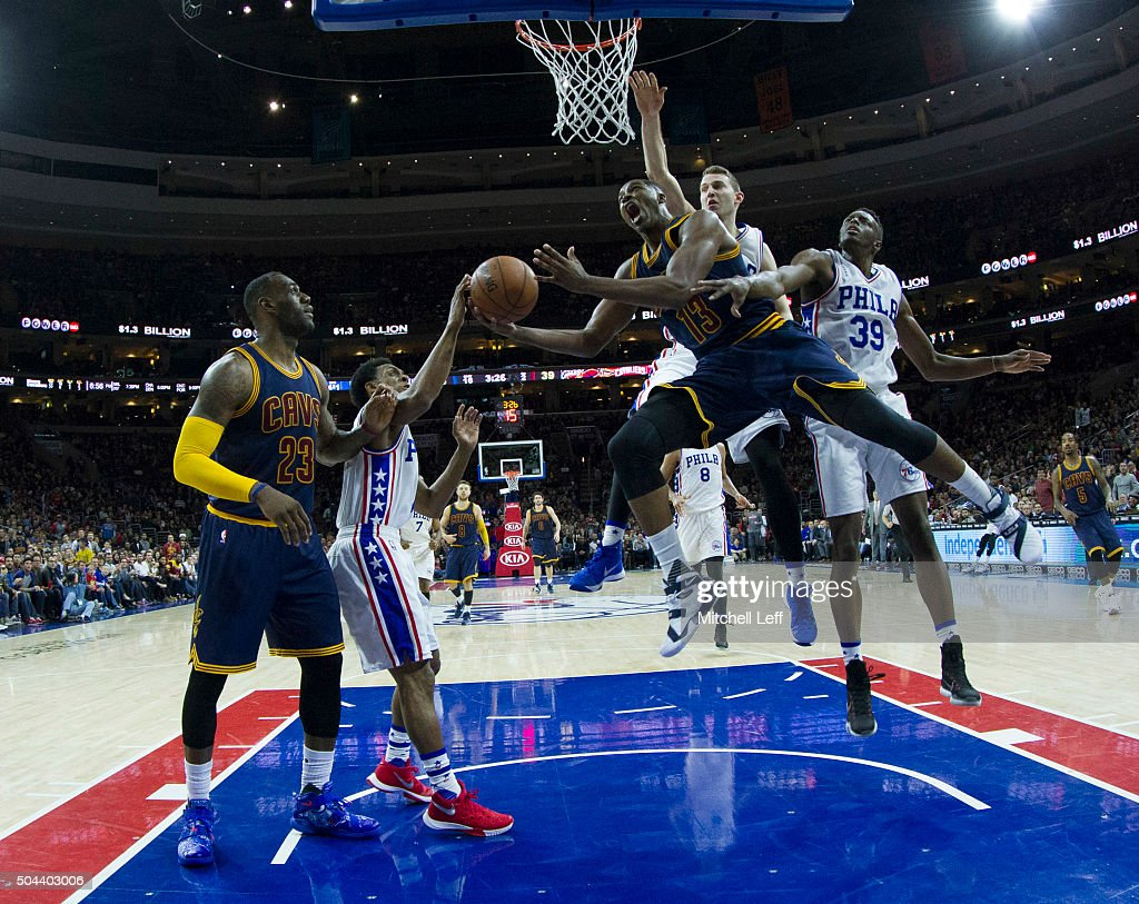 Tristan Thompson #13 of the Cleveland Cavaliers attempts a shot over Ish Smith #1, Nik Stauskas #11, and Jerami Grant #39 of the Philadelphia 76ers on January 10, 2016 at the Wells Fargo Center in Philadelphia, Pennsylvania. The Cavaliers defeated the 76ers 95-85.