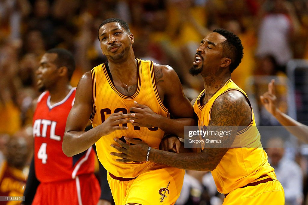Tristan Thompson of the Cleveland Cavaliers celebrates with JR Smith after making a basket at the buzzer at the end of the first quarter against the...