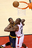Tristan Thompson of the Cleveland Cavaliers competes for position in the third quarter with Bismack Biyombo of the Toronto Raptors in game four of...