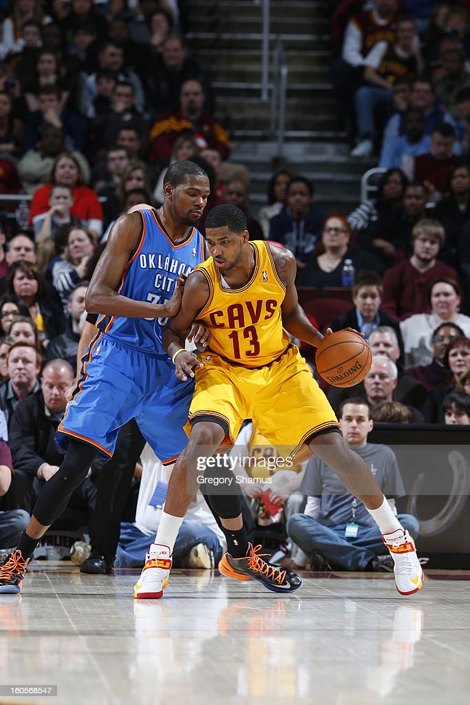 Tristan Thompson #13 of the Cleveland Cavaliers controls the ball against Kevin Durant #35 of the Oklahoma City Thunder at The Quicken Loans Arena on February 2, 2013 in Cleveland, Ohio.