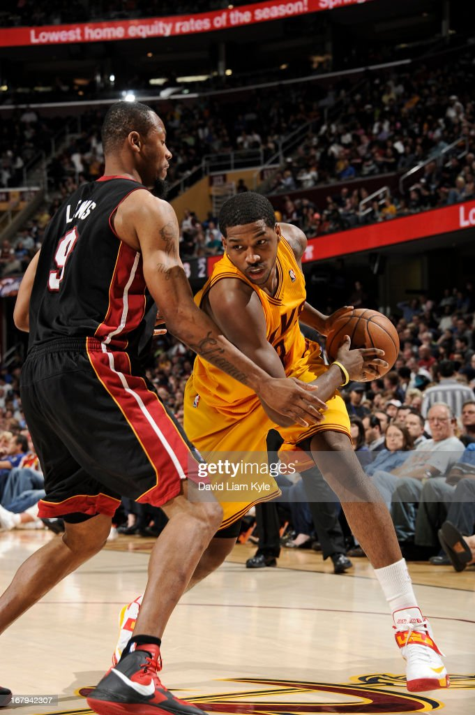 <a gi-track='captionPersonalityLinkClicked' href=/galleries/search?phrase=Tristan+Thompson&family=editorial&specificpeople=5799092 ng-click='$event.stopPropagation()'>Tristan Thompson</a> #13 of the Cleveland Cavaliers controls the ball against <a gi-track='captionPersonalityLinkClicked' href=/galleries/search?phrase=Rashard+Lewis&family=editorial&specificpeople=201713 ng-click='$event.stopPropagation()'>Rashard Lewis</a> #9 of the Miami Heat at The Quicken Loans Arena on April 15, 2013 in Cleveland, Ohio.