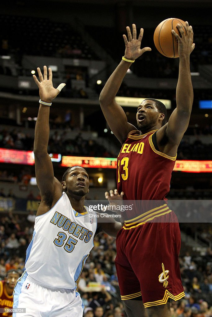 Tristan Thompson #13 of the Cleveland Cavaliers drives for a shot attempt against Kenneth Faried #35 of the Denver Nuggets at Pepsi Center on January 11, 2013 in Denver, Colorado.