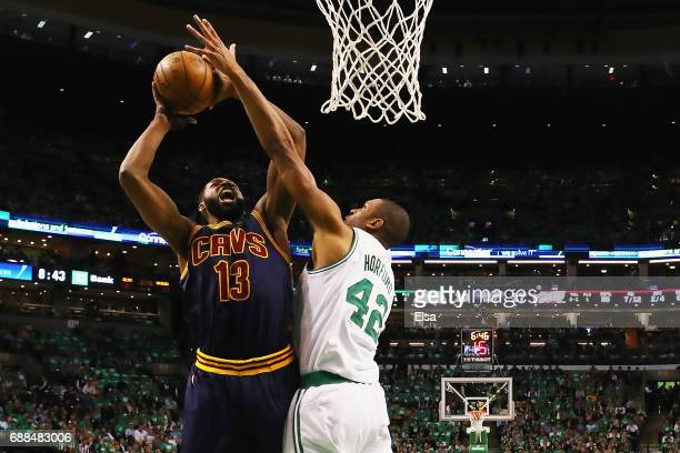 Tristan Thompson of the Cleveland Cavaliers drives to the basket against Al Horford of the Boston Celtics in the first half during Game Five of the...