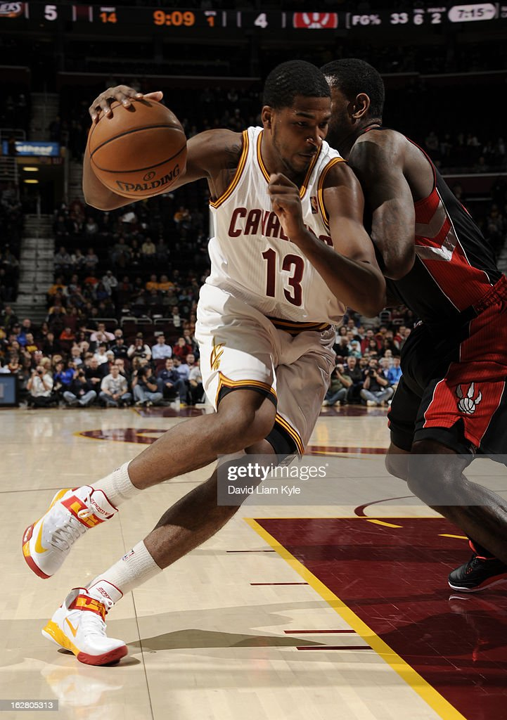 Tristan Thompson #13 of the Cleveland Cavaliers drives to the hoop against Amir Johnson #15 of the Toronto Raptors at The Quicken Loans Arena on February 27, 2013 in Cleveland, Ohio.