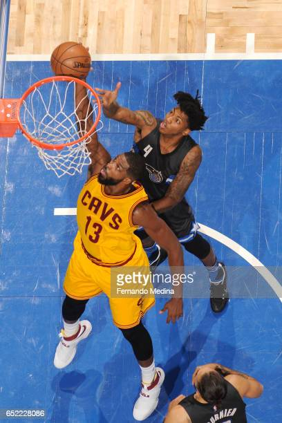 Tristan Thompson of the Cleveland Cavaliers dunks against Elfrid Payton of the Orlando Magic during the game on March 11 2017 at Amway Center in...