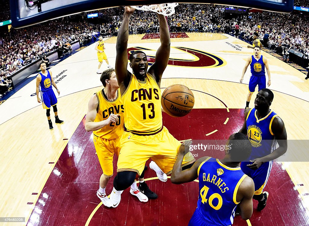 Tristan Thompson #13 of the Cleveland Cavaliers dunks against Harrison Barnes #40 of the Golden State Warriors in the first half during Game Three of the 2015 NBA Finals between the Golden State Warriors and the Cleveland Cavaliers at Quicken Loans Arena on June 9, 2015 in Cleveland, Ohio.