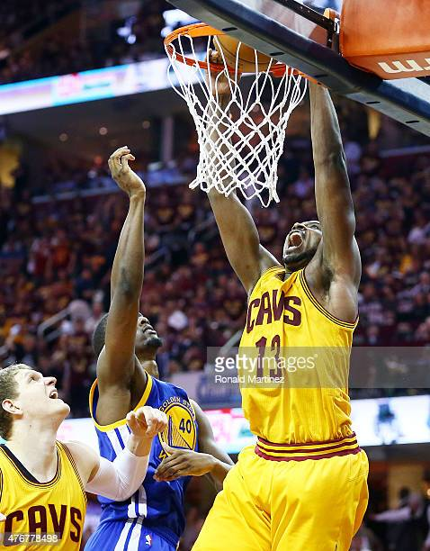 Tristan Thompson of the Cleveland Cavaliers dunks against Harrison Barnes of the Golden State Warriors in the third quarter during Game Four of the...
