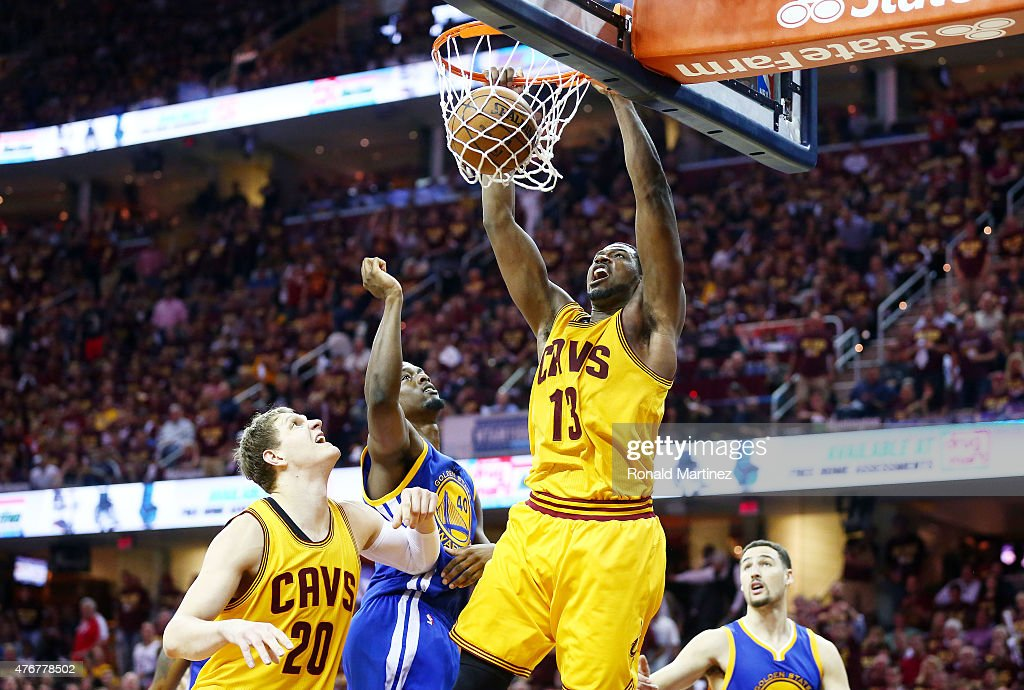 Tristan Thompson #13 of the Cleveland Cavaliers dunks against Harrison Barnes #40 of the Golden State Warriors in the third quarter during Game Four of the 2015 NBA Finals at Quicken Loans Arena on June 11, 2015 in Cleveland, Ohio.