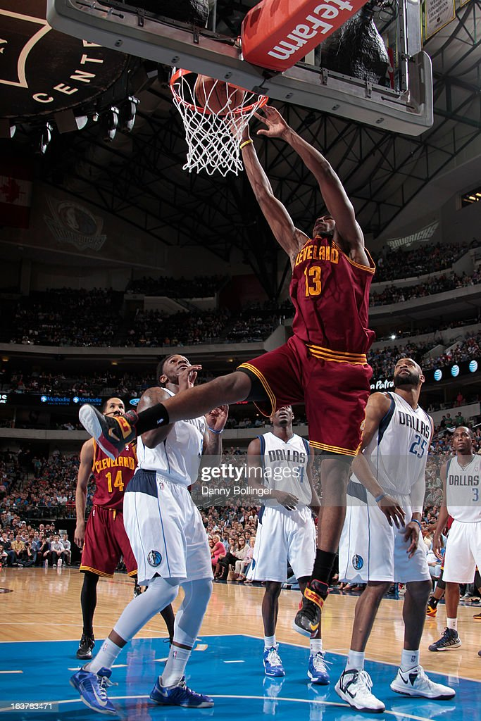 <a gi-track='captionPersonalityLinkClicked' href=/galleries/search?phrase=Tristan+Thompson&family=editorial&specificpeople=5799092 ng-click='$event.stopPropagation()'>Tristan Thompson</a> #13 of the Cleveland Cavaliers dunks against <a gi-track='captionPersonalityLinkClicked' href=/galleries/search?phrase=Jae+Crowder&family=editorial&specificpeople=7357507 ng-click='$event.stopPropagation()'>Jae Crowder</a> #9 and <a gi-track='captionPersonalityLinkClicked' href=/galleries/search?phrase=Vince+Carter&family=editorial&specificpeople=201488 ng-click='$event.stopPropagation()'>Vince Carter</a> #25 of the Dallas Mavericks on March 15, 2013 at the American Airlines Center in Dallas, Texas.