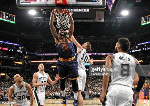 Tristan Thompson of the Cleveland Cavaliers dunks against Pau Gasol of the San Antonio Spurs at ATT Center on March 27 2017 in San Antonio Texas NOTE...