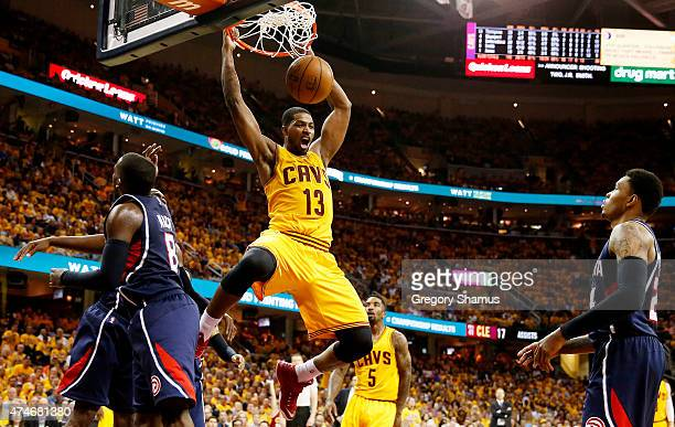 Tristan Thompson of the Cleveland Cavaliers dunks against the Atlanta Hawks in the fourth quarter during Game Three of the Eastern Conference Finals...