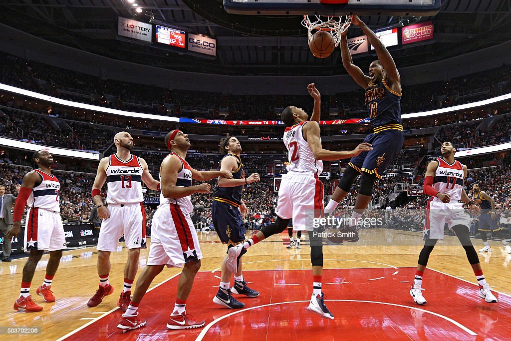 Tristan Thompson #13 of the Cleveland Cavaliers dunks in front of Otto Porter Jr. #22 of the Washington Wizards and teammates during the second half at Verizon Center on January 6, 2016 in Washington, DC. The Cleveland Cavaliers won, 121-115.