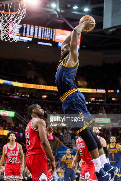 Tristan Thompson of the Cleveland Cavaliers dunks over Dwyane Wade of the Chicago Bulls during the first half against the Chicago Bulls at Quicken...