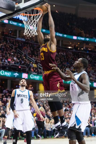 Tristan Thompson of the Cleveland Cavaliers dunks over Gorgui Dieng of the Minnesota Timberwolves during the second half at Quicken Loans Arena on...