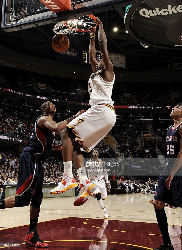 Tristan Thompson #13 of the Cleveland Cavaliers dunks the ball against Al Horford #15 and Kyle Korver #26 of the Atlanta Hawks at The Quicken Loans Arena on January 9, 2013 in Cleveland, Ohio.