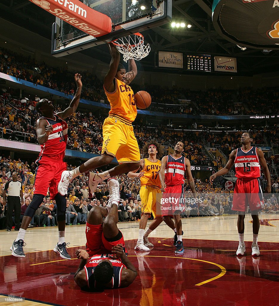<a gi-track='captionPersonalityLinkClicked' href=/galleries/search?phrase=Tristan+Thompson&family=editorial&specificpeople=5799092 ng-click='$event.stopPropagation()'>Tristan Thompson</a> #13 of the Cleveland Cavaliers dunks the ball against <a gi-track='captionPersonalityLinkClicked' href=/galleries/search?phrase=Chris+Singleton&family=editorial&specificpeople=241555 ng-click='$event.stopPropagation()'>Chris Singleton</a> #31 of the Washington Wizards at The Quicken Loans Arena on October 30, 2012 in Cleveland, Ohio.