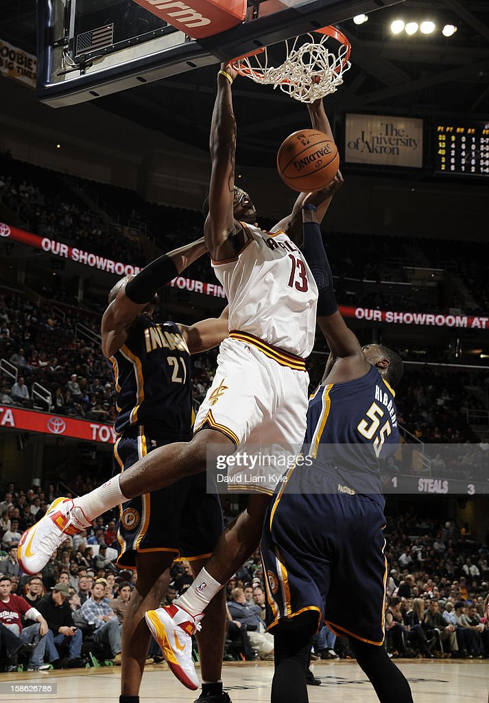 <a gi-track='captionPersonalityLinkClicked' href=/galleries/search?phrase=Tristan+Thompson&family=editorial&specificpeople=5799092 ng-click='$event.stopPropagation()'>Tristan Thompson</a> #13 of the Cleveland Cavaliers dunks the ball against David West #21 and <a gi-track='captionPersonalityLinkClicked' href=/galleries/search?phrase=Roy+Hibbert&family=editorial&specificpeople=725128 ng-click='$event.stopPropagation()'>Roy Hibbert</a> #55 of the Indiana Pacers at The Quicken Loans Arena on December 21, 2012 in Cleveland, Ohio.