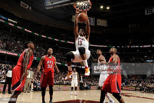 Tristan Thompson of the Cleveland Cavaliers dunks the ball against Mike Scott of the Atlanta Hawks at The Quicken Loans Arena on December 26 2013 in...