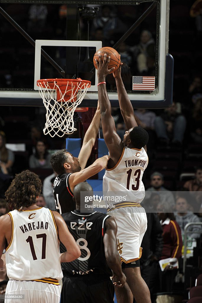 <a gi-track='captionPersonalityLinkClicked' href=/galleries/search?phrase=Tristan+Thompson&family=editorial&specificpeople=5799092 ng-click='$event.stopPropagation()'>Tristan Thompson</a> #13 of the Cleveland Cavaliers dunks the ball over Tomas Ress #14 of the Montepaschi Siena during the game between the Montepaschi Siena and the Cleveland Cavaliers at The Quicken Loans Arena on October 8, 2012 in Cleveland, Ohio.
