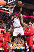 Tristan Thompson of the Cleveland Cavaliers fights for a rebound over Al Horford Mike Scott of the Atlanta Hawks during the first half of the NBA...