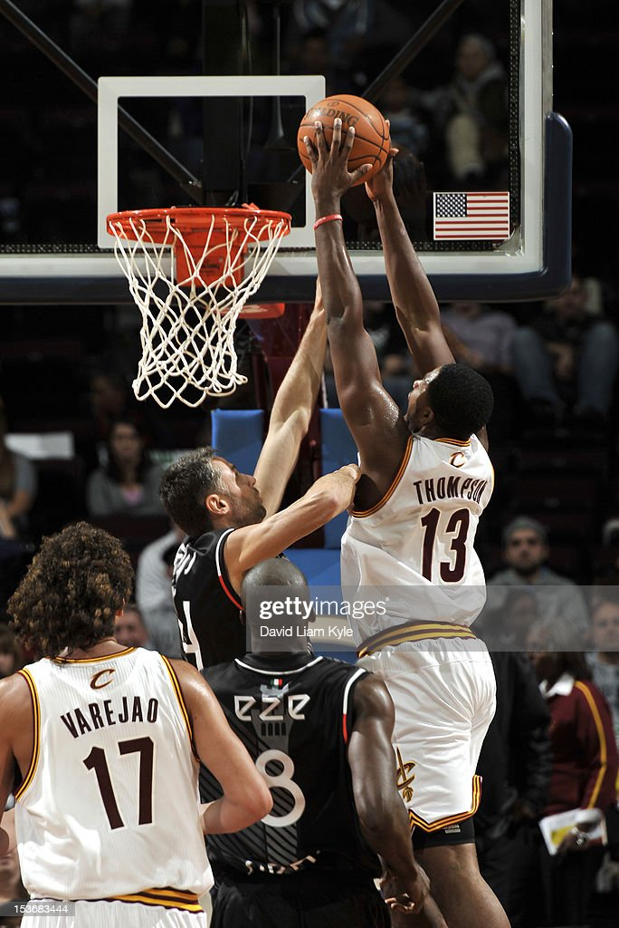 <a gi-track='captionPersonalityLinkClicked' href=/galleries/search?phrase=Tristan+Thompson&family=editorial&specificpeople=5799092 ng-click='$event.stopPropagation()'>Tristan Thompson</a> #13 of the Cleveland Cavaliers goes for a dunk over Tomas Ress #34 of the Montepaschi Siena during the game between the Montepaschi Siena and the Cleveland Cavaliers at The Quicken Loans Arena on October 8, 2012 in Cleveland, Ohio.