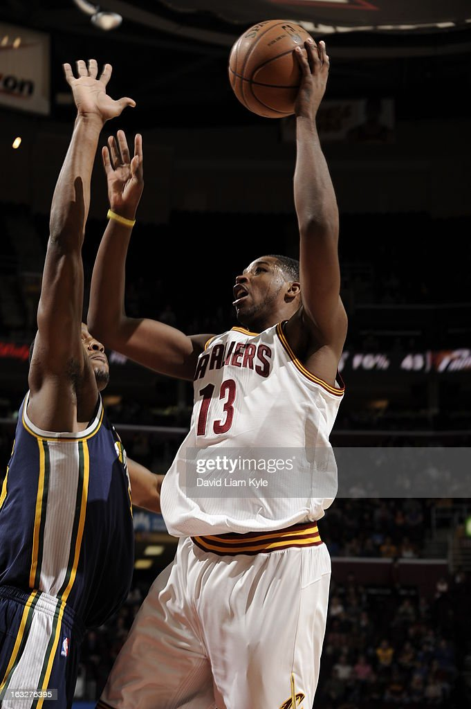 Tristan Thompson #13 of the Cleveland Cavaliers goes for a jump shot under pressure during the game between the Cleveland Cavaliers and the Utah Jazz at The Quicken Loans Arena on March 6, 2013 in Cleveland, Ohio.