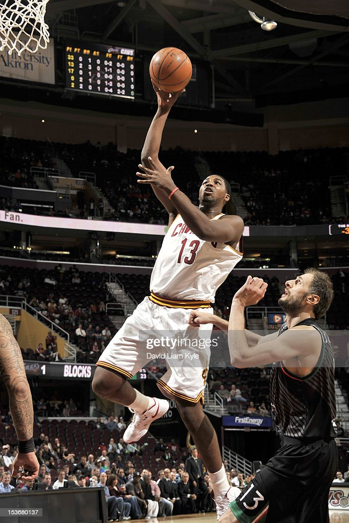 Tristan Thompson #13 of the Cleveland Cavaliers goes to the basket against Viktor Sanikidze #13 of the Montepaschi Siena during the game between the Montepaschi Siena and the Cleveland Cavaliers at The Quicken Loans Arena on October 8, 2012 in Cleveland, Ohio.