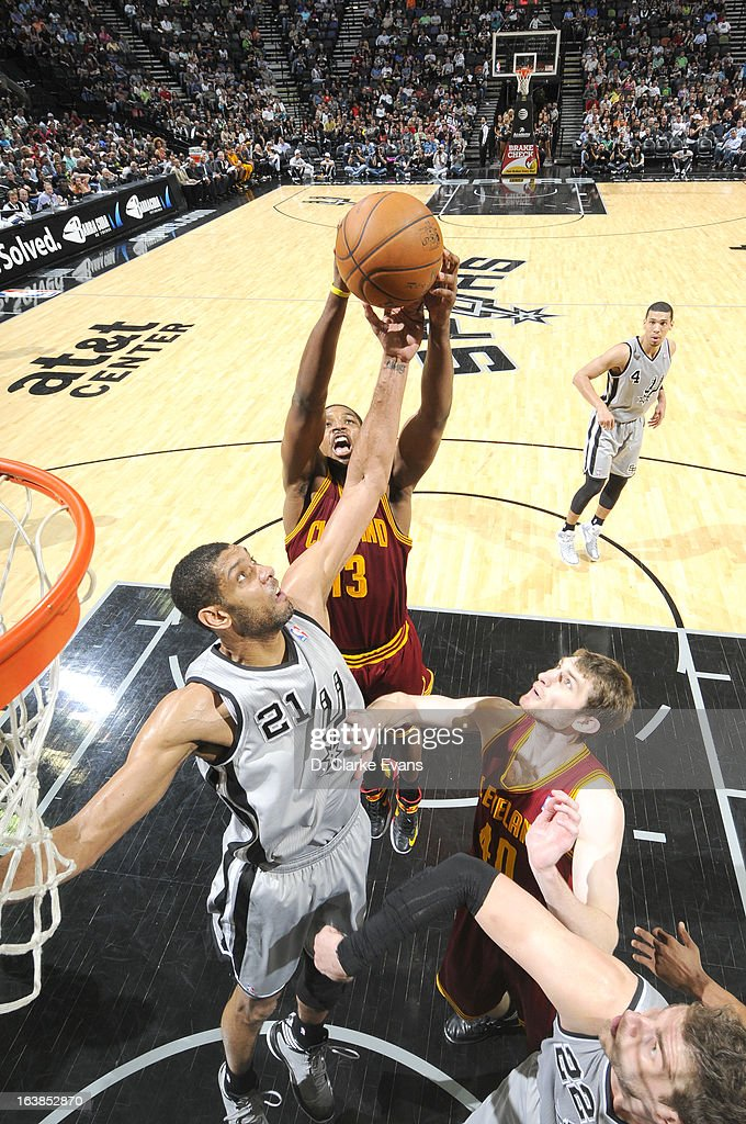 <a gi-track='captionPersonalityLinkClicked' href=/galleries/search?phrase=Tristan+Thompson&family=editorial&specificpeople=5799092 ng-click='$event.stopPropagation()'>Tristan Thompson</a> #13 of the Cleveland Cavaliers goes to the basket against <a gi-track='captionPersonalityLinkClicked' href=/galleries/search?phrase=Tim+Duncan&family=editorial&specificpeople=201467 ng-click='$event.stopPropagation()'>Tim Duncan</a> #21 of the San Antonio Spurs during the game between the Cleveland Cavaliers and the San Antonio Spurs on March 16, 2013 at the AT&T Center in San Antonio, Texas.