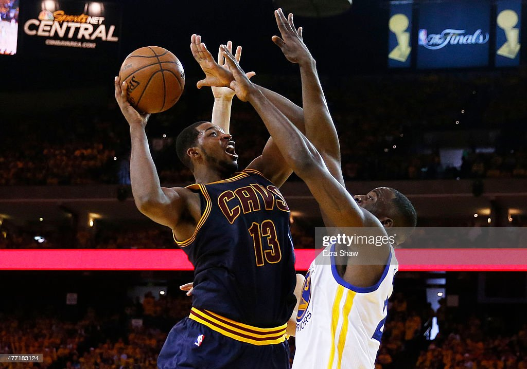 Tristan Thompson #13 of the Cleveland Cavaliers goes up against Draymond Green #23 of the Golden State Warriors in the third quarter during Game Five of the 2015 NBA Finals at ORACLE Arena on June 14, 2015 in Oakland, California.