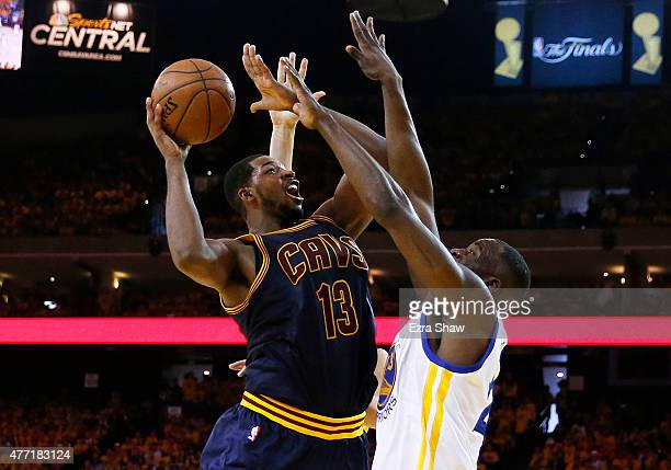 Tristan Thompson of the Cleveland Cavaliers goes up against Draymond Green of the Golden State Warriors in the third quarter during Game Five of the...