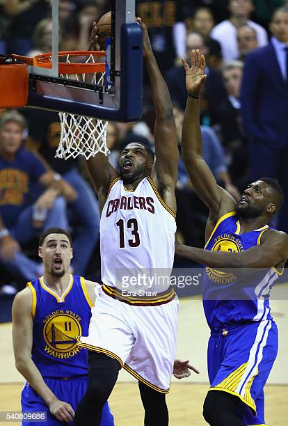 Tristan Thompson of the Cleveland Cavaliers goes up for a dunk in the first half against Klay Thompson and Festus Ezeli of the Golden State Warriors...