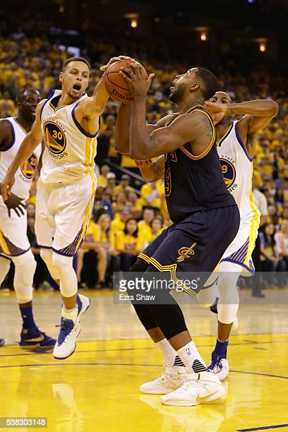 Tristan Thompson of the Cleveland Cavaliers goes up for a shot against Stephen Curry of the Golden State Warriors in Game 2 of the 2016 NBA Finals at...