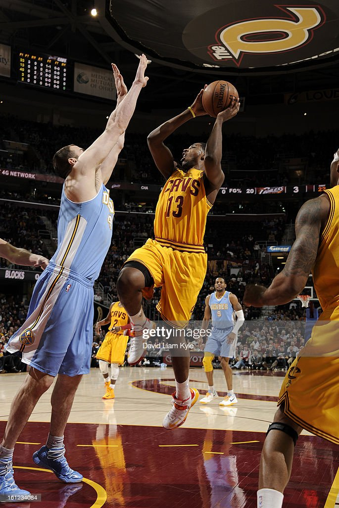 Tristan Thompson #13 of the Cleveland Cavaliers goes up for the shot against Kosta Koufos #41 of the Denver Nuggets at The Quicken Loans Arena on February 9, 2013 in Cleveland, Ohio.