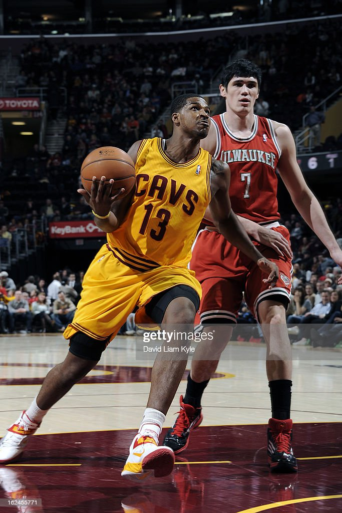 <a gi-track='captionPersonalityLinkClicked' href=/galleries/search?phrase=Tristan+Thompson&family=editorial&specificpeople=5799092 ng-click='$event.stopPropagation()'>Tristan Thompson</a> #13 of the Cleveland Cavaliers goes up for the shot against <a gi-track='captionPersonalityLinkClicked' href=/galleries/search?phrase=Ersan+Ilyasova&family=editorial&specificpeople=557070 ng-click='$event.stopPropagation()'>Ersan Ilyasova</a> #7 of the Milwaukee Bucks at The Quicken Loans Arena on January 25, 2013 in Cleveland, Ohio.