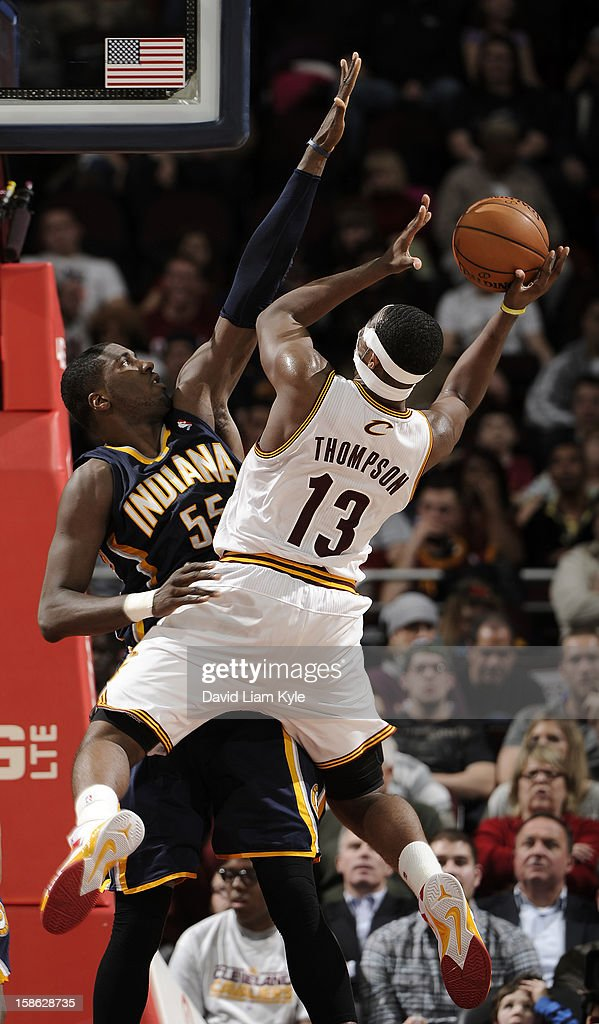 <a gi-track='captionPersonalityLinkClicked' href=/galleries/search?phrase=Tristan+Thompson&family=editorial&specificpeople=5799092 ng-click='$event.stopPropagation()'>Tristan Thompson</a> #13 of the Cleveland Cavaliers goes up for the shot against <a gi-track='captionPersonalityLinkClicked' href=/galleries/search?phrase=Roy+Hibbert&family=editorial&specificpeople=725128 ng-click='$event.stopPropagation()'>Roy Hibbert</a> #55 of the Indiana Pacers at The Quicken Loans Arena on December 21, 2012 in Cleveland, Ohio.