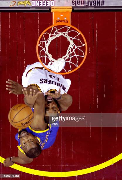 Tristan Thompson of the Cleveland Cavaliers goes up with the ball against Kevin Durant of the Golden State Warriors in the first half in Game 3 of...
