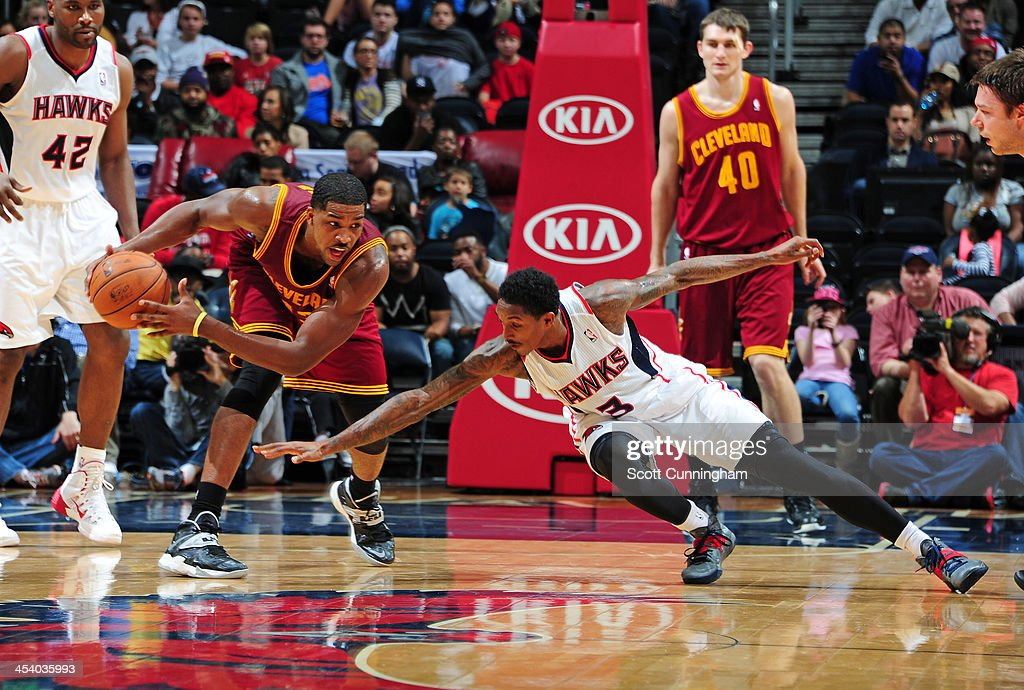 <a gi-track='captionPersonalityLinkClicked' href=/galleries/search?phrase=Tristan+Thompson&family=editorial&specificpeople=5799092 ng-click='$event.stopPropagation()'>Tristan Thompson</a> #13 of the Cleveland Cavaliers grabs a loose ball against the Atlanta Hawks on December 6, 2013 at Philips Arena in Atlanta, Georgia.